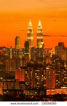 Sunset skyline of Kuala Lumpur city with Petronas Twin Towers or Kuala Lumpur City Centre (KLCC) as part of the skyline.