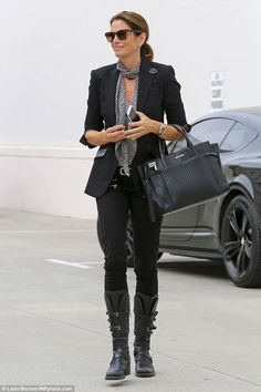 Biker girl: The 50-year-old donned heavily buckled motorcycle boots and skinny jeans for her upscale pampering session