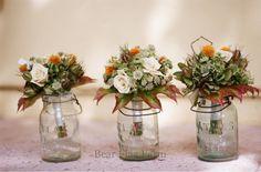 Mason jar arrangements are a staple of farm-fresh décor for home and weddings.
