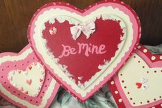 A valentine wall plaque that I bought on clearance @ Target. I completely re-painted/embellished it.