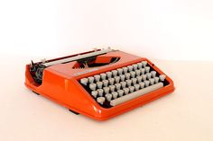 I don't think that 'need' is too strong of a word for what I feel when i see this.  I need an orange typewriter.  I'm pretty sure it would make me a better writer and overall improve my life.  Anyone want to spend $225 on a belated Christmas gift??