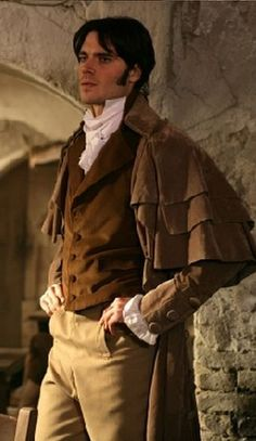 Brown waistcoat, buff breeches and caped greatcoat