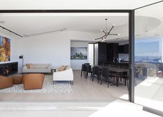 Love the track & suspended lighting in this space: Tamarama House | Porebski Architects | est living