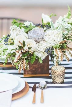 Brides.com: . Studio Fleurette created these stylish centerpieces that were filled with succulents, roses, tulips, and hydrangeas.