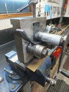 Ring Roller by 1/2 Cup -- Homemade ring roller constructed from threaded rod, bar stock, steel plate, and bearings. http://www.homemadetools.net/homemade-ring-roller-8