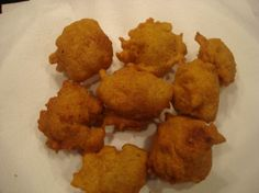 Hush Puppies Justin Wilson Style from Food.com:   								These are absolutely the greatest and go great with fried fish. This recipe is from the late Justin Wilson