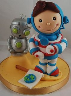 Great idea for a child's birthday cake! Carlos Lischetti teaches how to make his trademark colourful characters on a modelling course at Squires Kitchen.