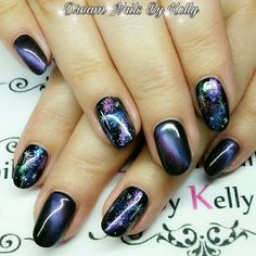 Purple cat eye gel polish with freehand nail art.