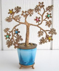 Vintage Jewelry Tree Coin Bank Japanese Cherry Blossom Moonglow Flowers Blue Slag Glass by VintageFunkandFlair on Etsy https://www.etsy.com/listing/220738867/vintage-jewelry-tree-coin-bank-japanese