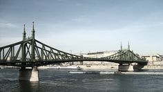 Liberty Bridge (Szabadság híd) connecting Buda (at the foot of the Gellért Hill) with Pest across the Danube. It was built between 1894 and Liberty Bridge, Tower Bridge, Budapest, Places To Travel, Architecture, Arquitetura, Architecture Illustrations, Travel Destinations, Architects