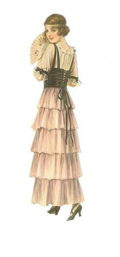 Vintage lady fashion.  woman in light pink spanish inspired dress and black corset, and fan