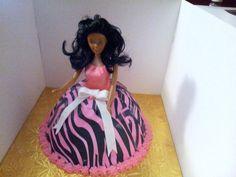 My daughters Barbie birthday cake I made with zebra print sugar