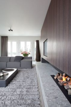 Living room in a private penthouse in Amsterdam. Living Room Tv, Living Room With Fireplace, Living Room Interior, Home And Living, Living Spaces, Interior Design Inspiration, Home Interior Design, Interior Decorating, Modern Fireplace