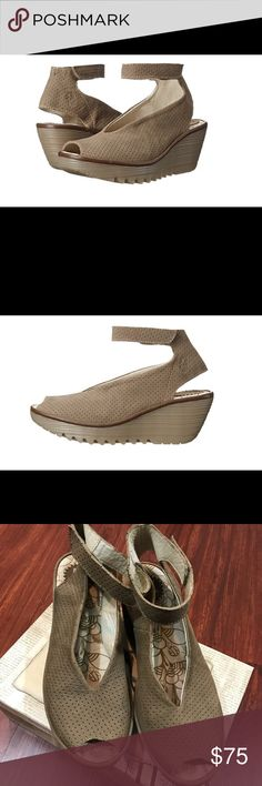 FLY London Womens Yala Perf Wedge Pump, Khaki, 40 Perforated leather upper. Hook-and-loop ankle strap closure. Soft leather lining. Lightly cushioned comfort footbed. Molded wedge heel. Rubber traction outsole. Imported. Product measurements were taken using size 39, width M. Please note that measurements may vary by size. Measurements: Heel Height: 2 1⁄4 in Weight: 15 oz Platform Height: 1 in Fly London Shoes Platforms
