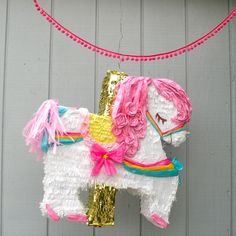 This carousel horse piñata would make a beautiful centerpiece at your next carnival or circus themed party.24 inches tall24 inches wide5 inches depth Pull ribbons are not available for this modelAll pieces are handcrafted in southern California upon order and take between 2-3 weeks to process. Rush orders may be available if our schedule permits so feel free to contact us if you're interested.Piñatas comes ready to fill and hang. Candy is NOT included.Order...
