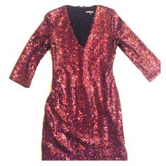 Express Dress Shell 100% nylon lining 100% polyester black and red sequin on she'll of dress Express Dresses Mini