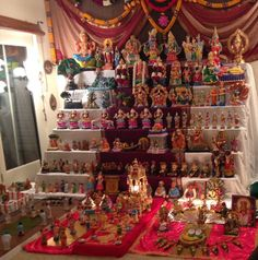 This is the 9 Nights of Doll Festival a religious festival mainly celebrated in Southern part of India. It's an exhibition of various dolls and Indian deities in odd numbered tiers (usually 7, 9, or 11).  Courtesy - Vidya Aravind