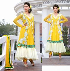 Yellow Net Salwar Kameez aetb10246 Price: 105 USD Beautiful Yellow Net Salwar Kameez embellished with resham embroidery with stone work and patch patta work.  Salwar Kameez comes with Matching santoon bottom and chiffon dupatta. This Unstitched Suit Fabric has maximum bust size of 42 inches.  For customized please submit your measurement at info@auraexclusive.com