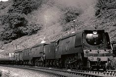 A pair of Battle of Britain Class 4-6-2 locomotives tackle the tough gradient out of Ilfracombe