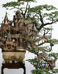 I think these are the coolest things! They are little miniature castles/worlds built around real, living bonsai trees.