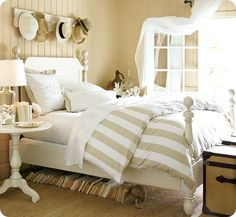 The bold stripe bedding adds to the wonderful style of this bedroom!