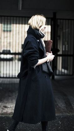 Bundle up in a thick black coat.