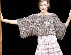 """From the magazine:  """"This crocheted side-to-side pullover is super easy to make - two unshaped rectangles are seamed at the top and bottom and left open in the center, making openings for the head and torso. In a rustic tweed, the picked-up ruffles and boxy shape are ruggedly sophisticated."""""""
