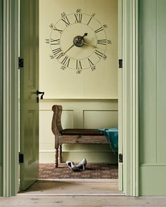 Love the stenciled wall clock (antique-looking). Can't find many clocks I like so I'd rather paint this and buy the parts to attach to the wall.     From Martha Stewart website