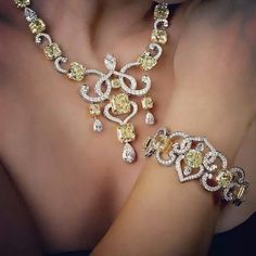 Our Fancy Yellow Radiant Swirls Diamond Necklace and Bracelet over 160 carats. William Goldberg