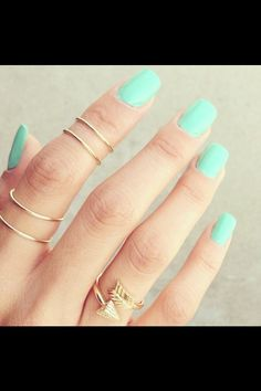 Seafoam green nails with gold midi rings -love