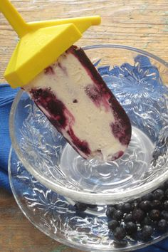 Blueberry Creamsicles! Fresh berries and a cheesecake like filling make a delicious frozen treat.