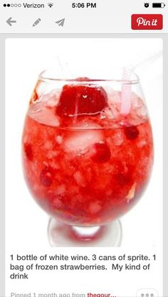 Strawberry wine spritzer. A bottle of wine wine, 3 cans of Sprite, and bag of frozen strawberries, crushed.