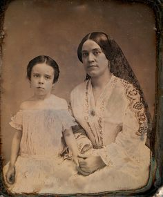 1/6th-Plate Daguerreotype of Woman and Daughter, Probably Early Californians, Circa 1852 by lisby1, via Flickr Woman is wearing a dark colored lace mantilla and may be Hispanic. The image originated in California.