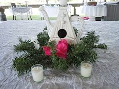 Centerpieces were birdhouses - have you ever seen a teapot birdhouse - so cute!