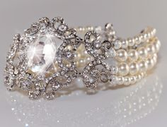 MELINDA Collection Vintage Inspired Swarovski Pearls and Rhinestone Wedding Bracelet Stunning Rhinestone Bracelet is handmade with Rhinestone centerpiece and finished with 4 strands of genuine Swarovs Wedding Bracelet, Wedding Jewelry, Diy Jewelry, Rhinestone Wedding, Lace Wedding, Wedding Dresses, Dream Wedding, Bridal Jewelry Vintage, Cute Wedding Ideas