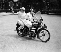 Working on her shot while going for a spin - this lady and her pal set off on a motorbike to play tennis in 1925.