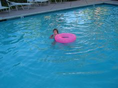 kid swims in pool