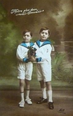 Vintage collored postcard with two boys in white sailor suits