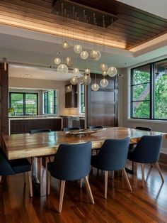 Home Decoration Ideas: 64 Modern Dining room ideas. Love the chairs and the light fitting - needs some light walls to balance the look though.