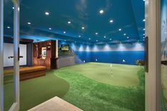 This home in Orange County, Calif., built by Dugally Oberfeld, has a 5,000-square-foot basement with an elaborate golf-simulation center and bar modeled after the Tap Room bar at Pebble Beach.