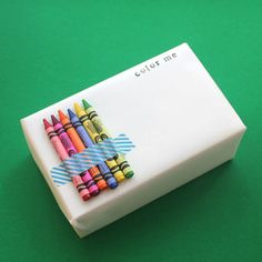 You can also add crayons to your gift-wrap to make present time a little more interactive.