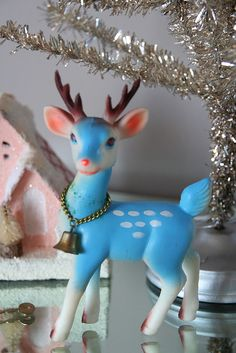 I have 2 of these deers,they were my mamaw's,but,they are not blue,they are cream colored....they have been around for at least 50 years or more