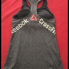 Women's Reebok CrossFit Tank M Stretchy, slim fit tank with bra top. Size M, washed once but never worn. Reebok Tops Tank Tops