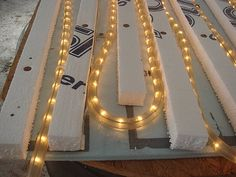 Recycling rope lights turn out to be a great way to make bottom heat for seed starting under lights.