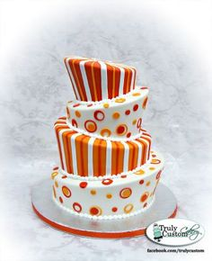 I hate topsy-turvy cakes, but love the colors and designs on this one