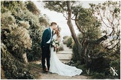 Couple, Front facing, Full body shot, Trees, greenery, bridge, kissing,  Casual or formal outfit