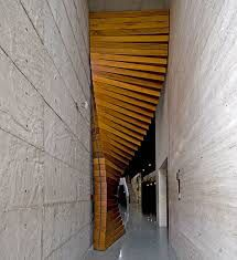 Designed by the architectural firm Matharoo Associates, the Curtain Door is most definitely a door like no other I've seen. The massive door is made of 40 sections of thick Burma teak and sits between the entrance's concrete walls Door Entryway, Entrance Doors, Doorway, Art And Architecture, Architecture Details, Organic Architecture, Architecture Interiors, Door Curtains, Curtain Door