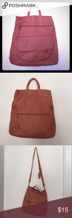 Pink/corral color pleather bag. Brand new! Adorable bag. Can be worn with long or short strap. Bueno Bags Crossbody Bags