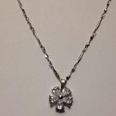 Platinum plated and cubic zirconia pendant. New. Gorgeous flower shaped CZ pendant. Platinum plated. Brand new. Never worn. Size is 1.3*1.3cm and length is 40cm Jewelry