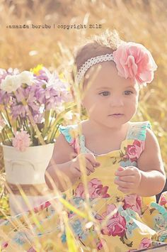 So pretty and simple for baby girl. Floral or frilly dress, make your own field of flowers w a backdrop of pretty bouquets in a vase